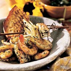 For authentic Mediterranean flavor, these fish and shrimp kabobs are marinated in fennel, garlic, lemon, and oregano.