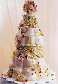 The wedding cake for Crown Prince Pavlos of Greece and Marie-Chantal Miller (the cake was made by Colette Peters). The main cake was eight tiers tall and was accompanied by 300 additional cakes, one per table. The cake design was inspired by a china pattern from the Royal Collection.