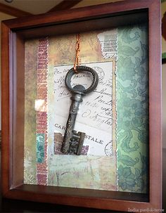 Nomadic Decorator | Travel Memento: Old Key Framed with Scrapbook Paper Scraps | http://nomadicdecorator.com