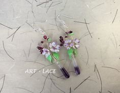 This is a new addition to my shop. Handmade using silver filled wire and Amethyst quartz teardrop. Purple - Burgundy cluster flower earrings. Long statement earring for those who like big size jewelry but still delicate looks. Unique wedding gift or personal use.
