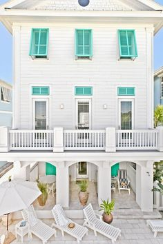 Coastal style home..............You have to have a great porch!  One that's wide and long for lounging and relaxing with fiends. Love the shutters too!
