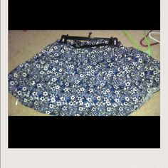 Forever 21 floral skirt !! navy blue  colored skirt with black and white colors with in the skirt as well ! There is a flower design or detail all over skirt.  Can be worn in fall with tights   or worn in summer. which ever you prefer. If you have any questions feel free to ask ! Forever 21 Skirts Mini
