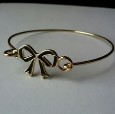 Adorable bow bangle bracelet! Worn once for a few hours; looks like perfect condition!  Bow design is hinged and unhooks for ease of use.  Seriously so cute and great to stack with other pieces! little black bag Jewelry Bracelets