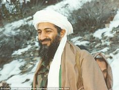 Entourage: A smiling Bin Laden is seen walking around Tora Bora surrounded by bodyguards, loyal followers and family members