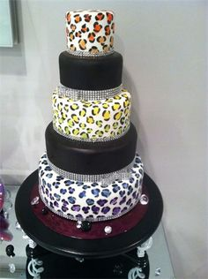 Hand painted rainbow leopard cake with some 'border bling'