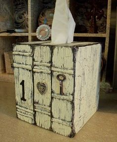 Decoupaged tissue box - a great blog for decoupage, elmers glue for crackle effect and more.....