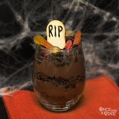Serve graveyard cake in wine goblets with personalized tombstones. #Halloween #wine