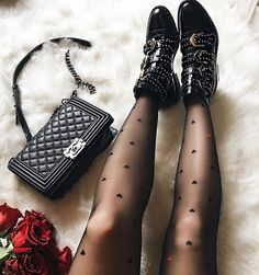 Chanel Boy bag and Givenchy boots for spring style. #fashionblogger #fashion #chanel #chanelboy #chanelbag #redroses #givenchy #boots #blackonblack #fabfashionfix