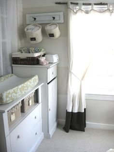 Storage bins and extra storage next to the changing table so you don't have to rely just on the space below.