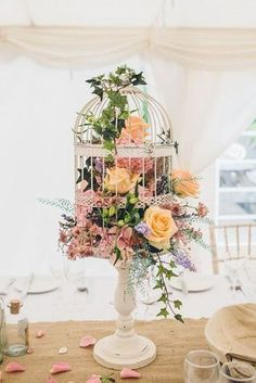 spring birdcage wedding centerpiece / http://www.himisspuff.com/love-birds-wedding-ideas-youll-love/5/