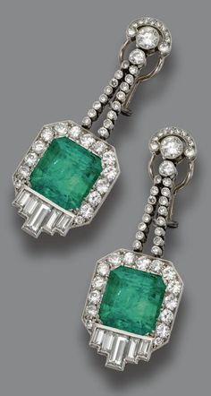 A pair of Art Deco emerald and diamond pendant-ear clips, circa 1935. Designed and fringes of round diamonds, anchored by 2 square emerald-cut emeralds weighing approximately 12.00 carats, surrounded by round and baguette diamonds, mounted in platinum. #ArtDeco #EarClips