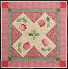 Free Appliqué Tulip Quilt Pattern: Just click on the word pattern highlighted in the text to download the pdf / http://dmc-threads.com/applique-quilt-pattern/