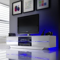 • A stunning contemporary TV stand with a gloss white finish• 4 Drawers with push open function and LED lights which can be adjusted to switch to several colours ,light changes to flash&n...