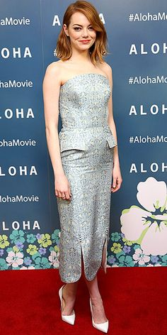 EMMA STONE in a gray strapless, geometric-printed Ulyana Sergeenko Couture design, which she accessorized with white pumps and a poppy coral lip at a screening of Aloha in London.