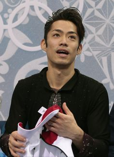 Daisuke Takahashi of Japan waits for his results after the men's short program figure skating competition at the Iceberg Skating Palace duri...