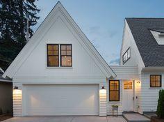 White Garage With Enclosed Breezeway Barn Light Sconces Bonus Room Above And Black Steel Windows