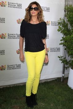 Daisy Fuentes pairs yellow denims with a black top