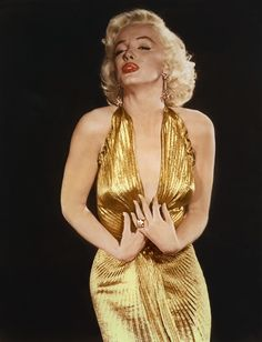 Marilyn Monroe in a pleated gold lame evening gown in GENTLEMEN PREFER BLONDES.