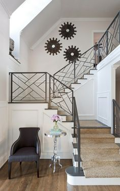 LOVE the twist on the traditional paneled staircase.