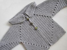 Crocheted baby sweater with an interesting construction. No gauge, yarn requirements or sizing information included in the pattern.