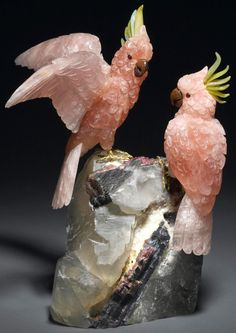 A pair of rose quartz cockatoos with serpentine, carnelian, and rubellite accents, mounted on a watermelon tourmaline-in-matrix base - Peter Mueller
