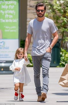 Daddy-daughter day: Scott decided to spend some of the day on Thursday with his adorable daughter Penelope, three