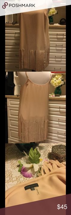 Vince Camuto Tunic/Top with fringe Really cute Vince Camuto camisole style top with Roaring 20s style fringe on the bottom.  Perfect with a pair of skinny jeans and high heels to dance the night away.  The color is a very pale pink, almost a blush color.  Worn only once. Vince Camuto Tops Tunics