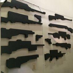 Cutouts from some gun cases decorate the warehouse walls Pelican Case, Gun Cases, Warehouse, Guns, Walls, Future, Ideas, Decor, Weapons Guns