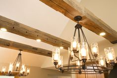Let there be light! Lighting was a challenge with this vaulted ceiling but the beams provide a beautiful solution