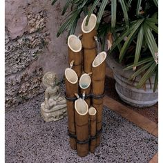 Up the Zen of your meditation garden with the Design Toscano Cascading Bamboo Sculptural Fountain . This bamboo sculpture is carved from water-resistant,. Bamboo Fountain, Tabletop Water Fountain, Garden Water Fountains, Water Garden, Outdoor Fountains, Outdoor Statues, Bamboo Garden, Resin Garden Statues, Buddha Sculpture