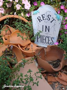 Here is an idea for displaying your garden planters no matter what their condition. ---  More upcycle for the garden at the end of the photo-link.