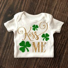 Kiss Me - St. Patrick's Day Onesie in Gold Glitter and Green Glitter. Baby girl sparkle shirt. www.shopcassidyscloset.com