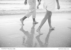 Couple walking on the beach | Photographer: Jacqui Cole