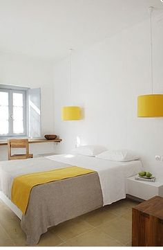 I just love the lamps in this room. I think it is smart to save space on your nightstand with those stupid clunky lamps - much like I have right now.