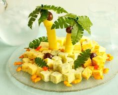 """This """"Cheddar Island"""" is an adorable and fanciful way to put out your summer cheese plate - or, in the dead of winter, when you're hosting that tropical-themed party to lift everyone's spirits... :)"""