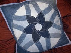 Recycled Jeans Quilt | denim jeans each cushion is a variation on the six petaled flower ...