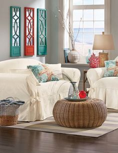 Convert Your Living Room Into a Beach Retreat  Long for the sound of crashing waves and the feel of sand between your toes? Make your living room your own beach retreat with a few easy details that won't break the bank. #Coastal living demands its share of seashells. Add a set of seashell prints to a bookcase ledge or display colorful coral on a side #table. A glass vase filled with seagrass and shells makes a perfect focal point for a coffee table or a centerpiece when dining.