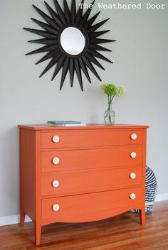 An Orange Milk Paint Dresser with Bone Knobs - The Weathered Door