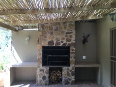Covered patio with build-in braai overlooking the garden. House Design, Pool House, House, New Home Designs, Outdoor Space, Patio Design, New Homes, Built In Braai, Outdoor Kitchen