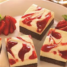 Strawberry Cheesecake Brownies - chocolate fudge brownies topped with a layer of cheesecake swirled with strawberry jam!
