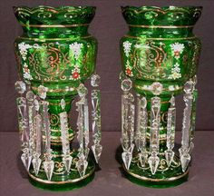 Found on EstateSales.NET: 221 - Pair of large green mantle lusters, double ring of prisms, 17in. T, 8in. Dia.
