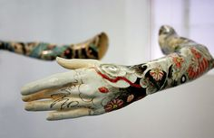 Min Jeong Seo's porcelain cast sculptures from the arms of ballet dancers painted with japanese Yakuza-style tattoo patterns.