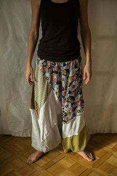 This upcycled patchwork harem pants are ideally designed for casual events, outdoor activities even yoga classes. Different patches of fabric are combined with dominating green color. The flowery patterns and light fabrics give these pants very casual and summery look. The pants can be used