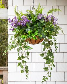 Good Images artificial Hanging Baskets Thoughts Hanging baskets will be the perfect way to get coloration and also crisis to the bright retaining wall and als. Artificial Hanging Baskets, Plants For Hanging Baskets, Hanging Pots, Hanging Flowers, Baskets On Wall, Fake Flowers, Hanging Ferns, Hanging Plants Outdoor, Diy Hanging