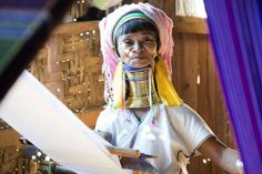 A woman with long neck from the Padaung tribe weaves in a workshop in Ywama near the Lake Inle, Myanmar.