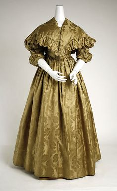 """Silk ensemble, American, ca. 1836. Marking: [hand written label] """"Dress Pa bought for Mother & had made in Philadelphia about the year 1836"""". Outfit includes gown, bertha, and detached lower sleeves."""