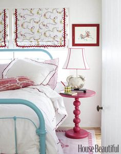Pink and turquoise accent the white bedroom of designer Kristen Ewart's 10-year-old niece. The fun, simple decor fits in perfectly with this colorful California beach house. Fun for a young girl.