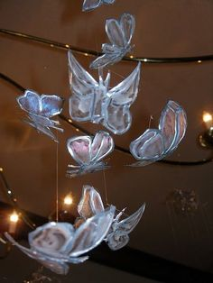 Instructable on how to make a Flight of Coke Butterflies -- clear plastic coke (drink) bottle, liquid lead (gray or silver), glass (or acrylic) paint, fishing line for hanging.