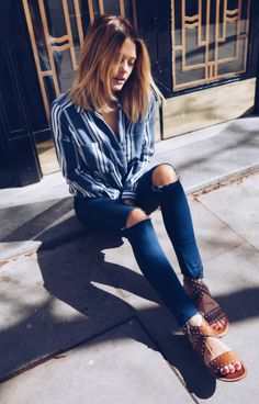 Wearing+a+patterned+shirt+and+denim+jeans+is+a+sure+fire+way+to+get+a+casual+and+sophisticated+spring+style+like+that+exhibited+here+by+Caroline+Receveur.+This+navy+striped+shirt+is+pretty+and+simple,+and+looks+great+worn+with+a+pair+of+leather+gladiator+style+sandals.+Shirt:+River+Island,+Sandals:+Dune.+