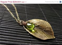 HOLIDAY SALE - Leaf Necklace in Bronze. Leaf Charm Necklace with Wire Wrapped Glass Teardrop Charm. Handmade Jewelry. on Etsy, $25.20